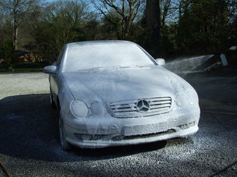Car gets snow foam pre-wash.