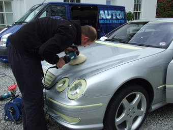 Polishing the car to a high gloss finish