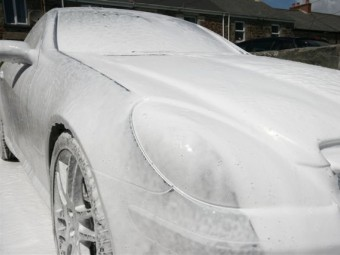 Car is covered in a blanket of foam.