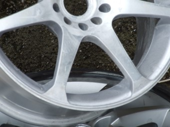 Wheel with kerb damage.